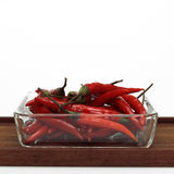 Fresh red chillies in bowl, close-up Stock Images