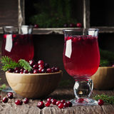 Fresh red cranberry juice on the vintage table Royalty Free Stock Photos
