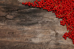 Fresh red currant berries on old wooden background Stock Photos