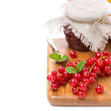 Fresh red currant and berry jam on board Royalty Free Stock Photo