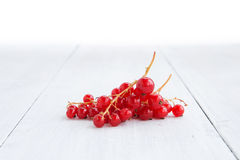 Fresh red currant on the light wooden background Stock Photo
