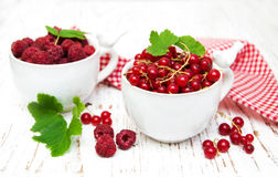 Fresh red currant and raspberries Stock Photo