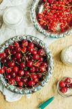 Fresh red currant on wooden table, bucket with red currant berri Stock Photography