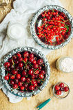 Fresh red currant on wooden table, bucket with red currant berri Royalty Free Stock Photography