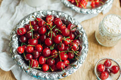 Fresh red currant on wooden table, bucket with red currant berri Stock Image