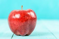 Fresh Red Delicious Apple On Turquoise Table Royalty Free Stock Photo