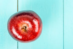 Fresh Red Delicious Apple On Turquoise Table Royalty Free Stock Photos