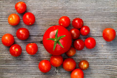 Fresh red delicious tomatoes on an old wooden tabletop Stock Photography