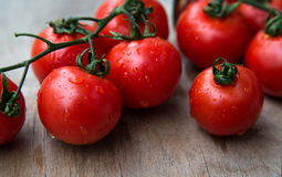 Fresh red delicious tomatoes  on an  old wooden tabletop, select Royalty Free Stock Photography