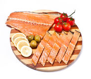 Fresh red fish fillet on plate with vegetables Royalty Free Stock Photo