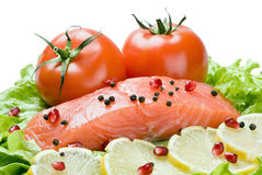 Fresh red fish with lemon and vegetables. Isolated on white background Stock Photo