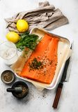 Fresh red fish Salmon fillet ready for salting, spices and knife. On white background stock photos