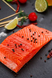 Fresh red fish salmon fillet and tomatoes, lime and chili pepper Royalty Free Stock Photo