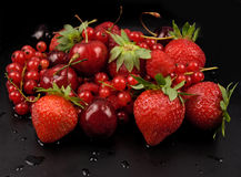 Fresh red  fruit on black Stock Photo