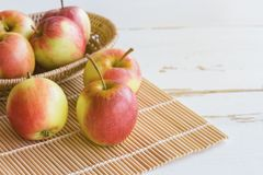 Fresh red fuji apple and in basket put on wood table for backgro royalty free stock images