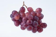 Fresh red grape. On white background Stock Photos