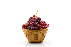 Fresh Red Grape in basket . Stock Photo