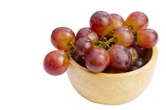 Fresh red grape in bowl isolated on white background. Clipping path Royalty Free Stock Image