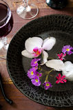 Fresh red grape juice and flowers. On wooden rustic table Stock Photos