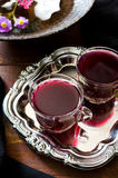 Fresh red grape juice and flowers. On wooden rustic table Royalty Free Stock Photo