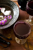 Fresh red grape juice and flowers. On wooden rustic table Royalty Free Stock Photography