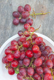 Fresh red grape. On white plate Royalty Free Stock Photos