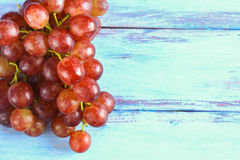 Fresh red grape on wooden table. Close up fresh red grape on wooden table top view with copy space Stock Photos