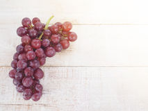 Fresh red grape. On wooden table, top view Stock Photography