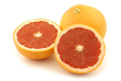 Fresh red grapefruit and a cut one Royalty Free Stock Image