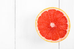 Fresh Red Grapefruit Slice On Table Royalty Free Stock Photo