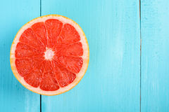 Fresh Red Grapefruit Slice On Table Royalty Free Stock Photos