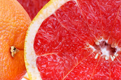 Fresh red grapefruit slices closeup stock images