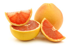 Fresh red grapefruit and some cut pieces Royalty Free Stock Images