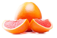 Fresh red grapefruits and slices Royalty Free Stock Image