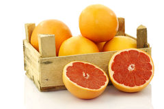 Fresh red grapefruits in a wooden box Stock Image