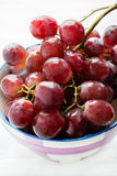 Fresh red grapes in bowl Royalty Free Stock Photos