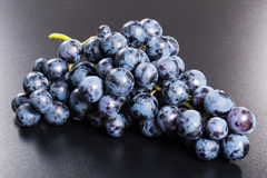 Fresh red grapes bunch on black background Royalty Free Stock Photography