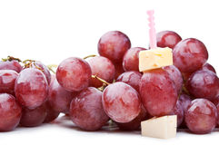 Fresh red grapes and canape with cheese Stock Photo