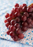 Fresh red grapes over blue background Stock Image