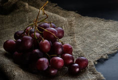 Fresh red grapes over rustic background Stock Photography
