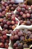 Fresh red grapes on store counter royalty free stock images
