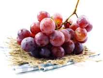 Fresh red grapes on tablecloth Royalty Free Stock Photo
