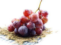 Fresh red grapes on tablecloth Royalty Free Stock Photos