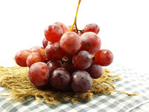 Fresh red grapes on tablecloth Stock Images