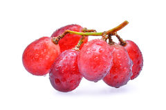 Fresh red grapes with water drops isolated on white background. Stock Images