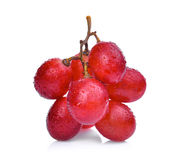 Fresh red grapes with water drops isolated on white Stock Image