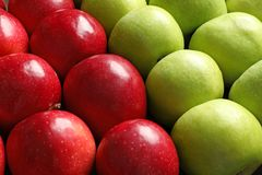 Fresh red and green apples,. Closeup royalty free stock image