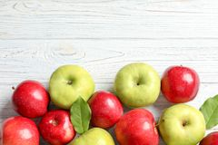 Fresh red and green apples on white wooden background. Top view Stock Image
