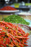Fresh red and green chili pepper. At a street fruits and vegetable market in Bangkok, Thailand Royalty Free Stock Photos