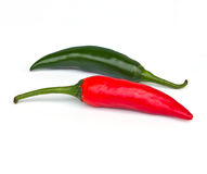 Fresh red and green chilli. On a white background royalty free stock images